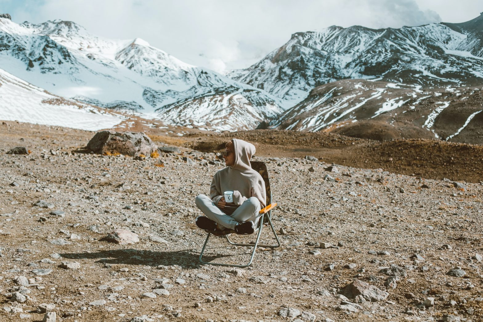 Meditating while drinking tea on a mountain
