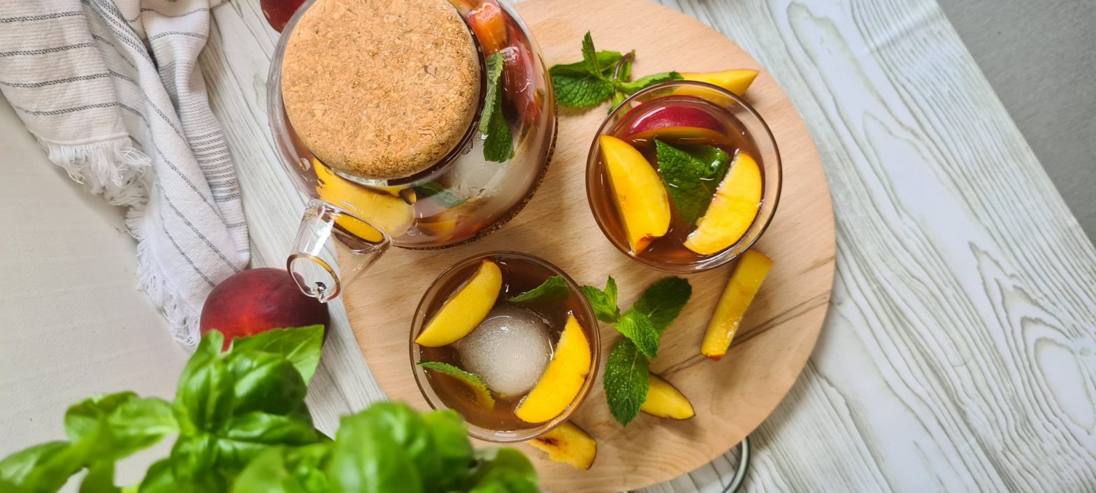 Peach-infused iced tea served in the Cortica collection teapot and cups